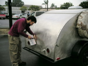 Dave putting on the brand new CA PTI license plate. That's $30 for 5 years, no stickers required.